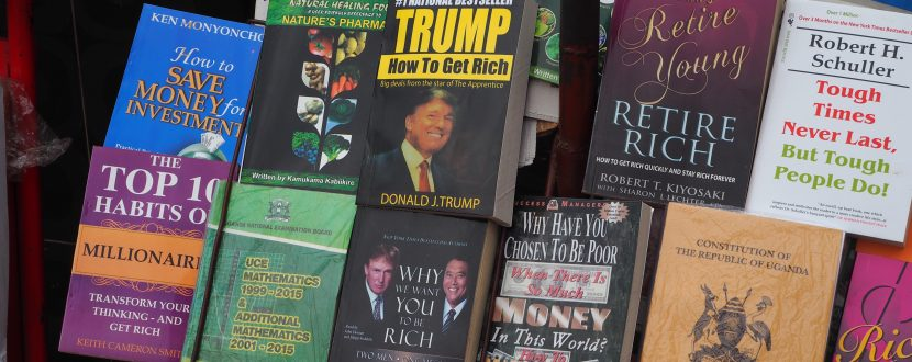 A Selection of self-help books at a vendor's parlour in downtown Kampala. Prominently featured: the books by Donald Trump. Right next to the Ugandan constitution. (Image: Jonas Bens)